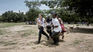 An MSF (Médecins Sans Frontières) nurse Kate Gannon leads the team who evacuate by helicopter 9 month pregnant Yanesi Fulakison, 38yo, who had pregnancy complications that prompted MSF staff on the field and from the emergency coordination office in Nsanje, to coordinate an emergency helicopter transport to the nearest hospital. Without urgent and immediate attention the lives of both mother and child were in jeopardy. Thanks to the rapidity of the response, after few hours Yanesi delivery by a cesarean surgery. Currently both of them are in good health.